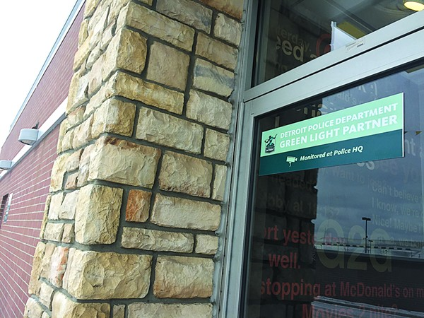 Project Green Light signage at a McDonald's on Eight Mile in Detroit. More than 230 businesses have invested thousands of dollars in the real-time surveillance program by Detroit police. - VIOLET IKONOMOVA