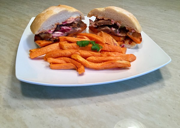 Pan con chicharron and sweet potato fries. - COURTESY PHOTO
