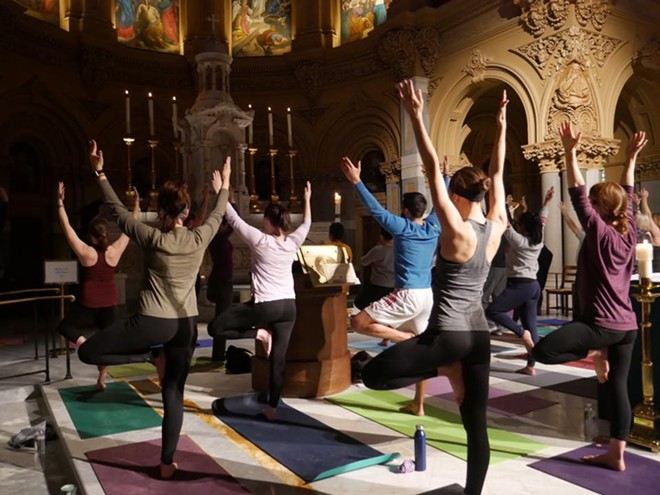 Yogis in tree pose during a Ignatian Yoga flow. - FACEBOOK/IGNATIAN YOGA