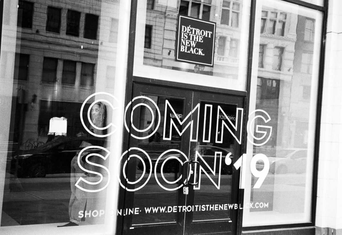 Roslyn Karamoko in the window of her soon-to-open Détroit Is the New Black store downtown.