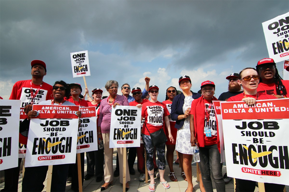 A group of airline catering workers and UNITE HERE Local 24 members are joined by Rep. Brenda Lawrence, Rep. Rashida Tlaib, and Rep. Andy Levin in solidarity at an informational picket at Detroit Metro Airport.