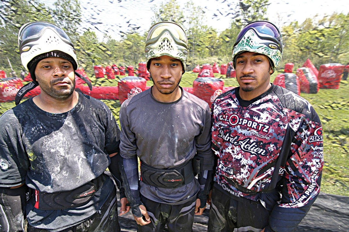 Lenard Covington, left, 38, of Farmington Hills, Michael Lloyd, 21, of Detroit, and Will Lloyd, 28, of Detroit, at a Detroit Action Paintball Practice in Taylor.