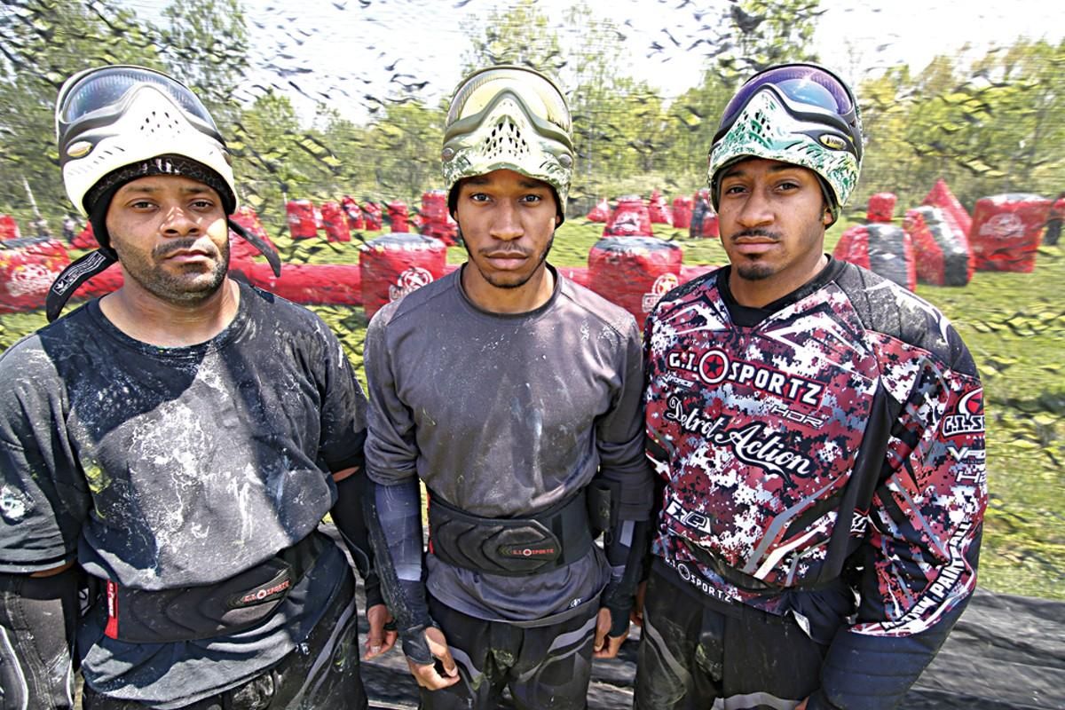 Lenard Covington, left, 38, of Farmington Hills, Michael Lloyd, 21, of Detroit, and Will Lloyd, 28, of Detroit, at a Detroit Action Paintball Practice in Taylor.