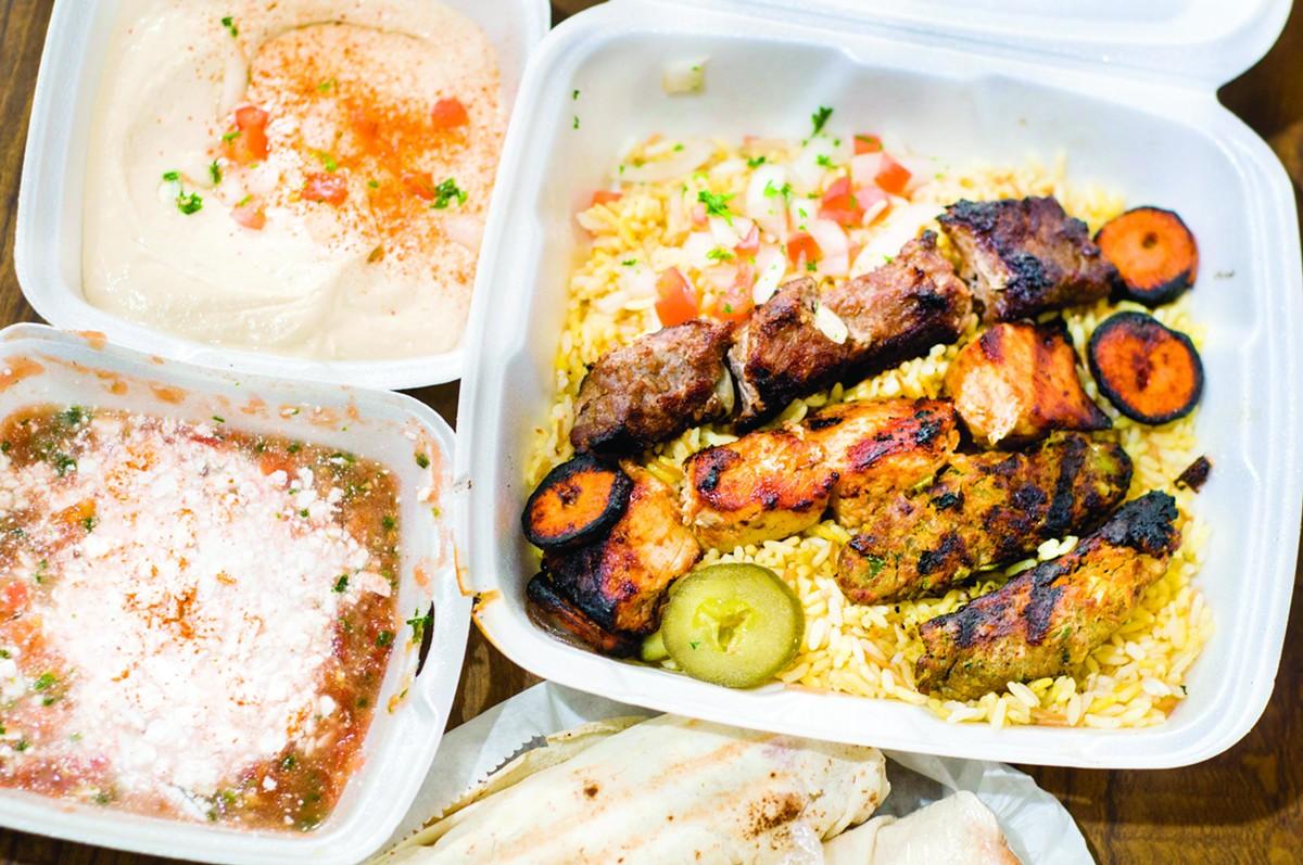 From top right, counterclockwise: Shish combo with Tahama kebab, beef shawarma and chicken tawook; hummus; sahawik with jubn; Tahama kebab sandwich.