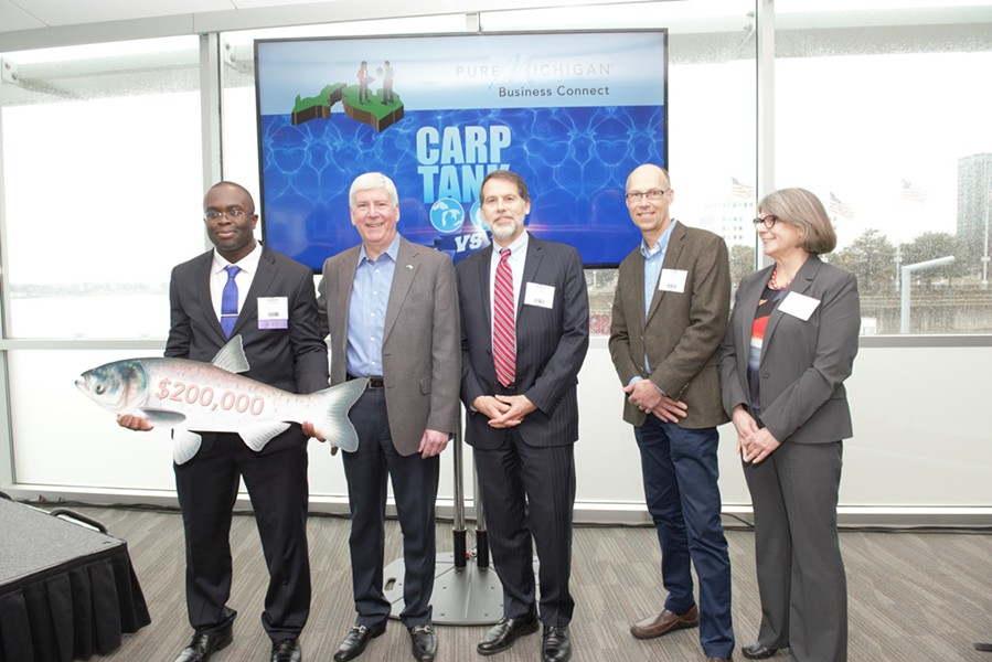 Edem Tsikata of Boston, Mass. accepts the grand prize at the Carp Tank from Gov. Rick Snyder, David Lodge, Jeff DeBoer and Dr. Denice Shaw. - COURTESY PHOTO
