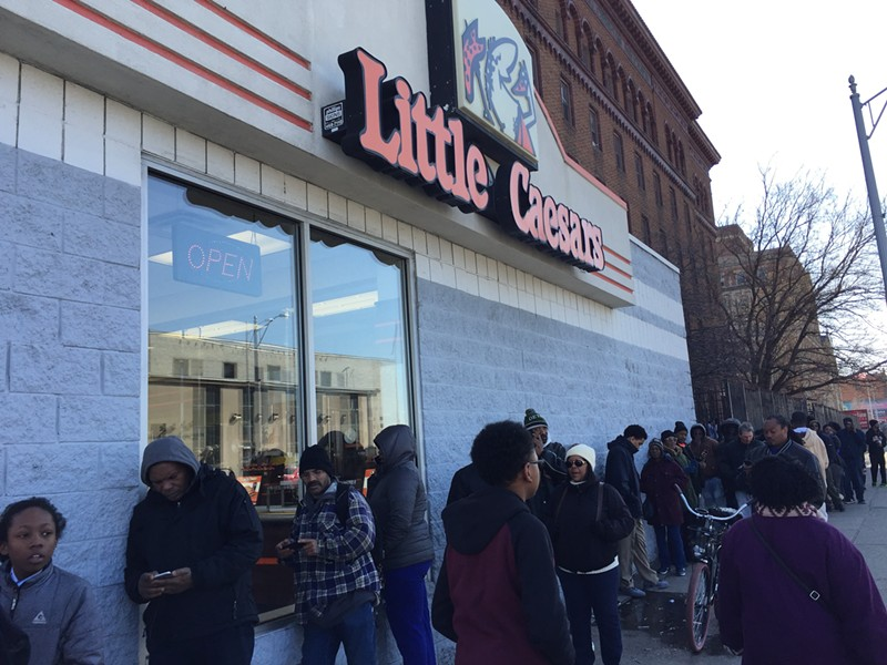 A line stretches down the street outside of Little Caesars in Highland Park during the Monday lunch hour. - ANTHONY SPAK