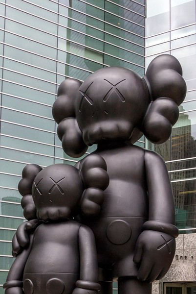 """""""Waiting,"""" statue by artist KAWS. - COURTESY PHOTO"""