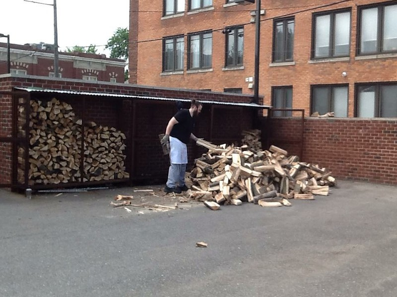 John chopping wood for the smoker at Slow's. - COURTESY PHOTO