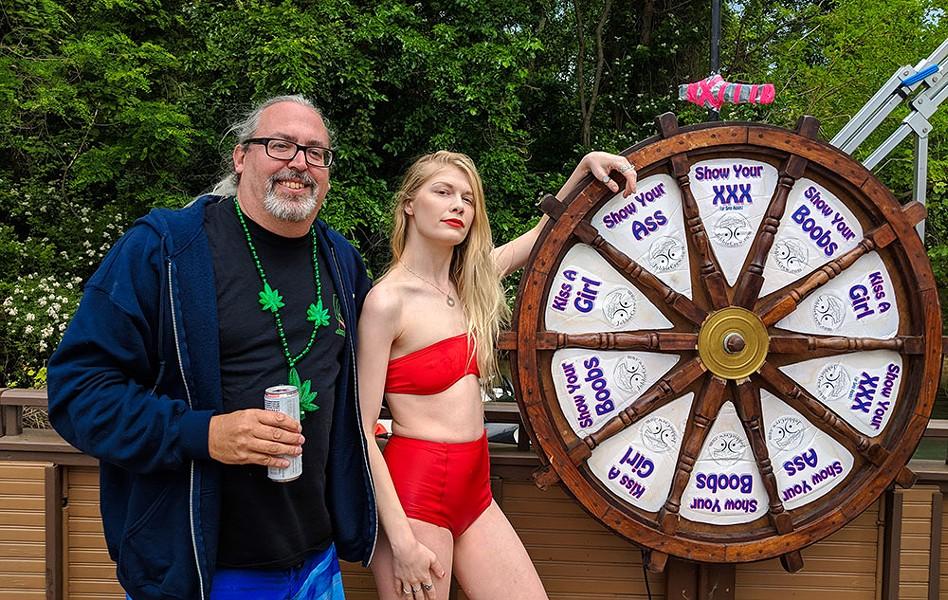 Captain Jim, the author, and Jobbie Nooner's Wheel of Destiny. - NOAH ELLIOTT MORRISON