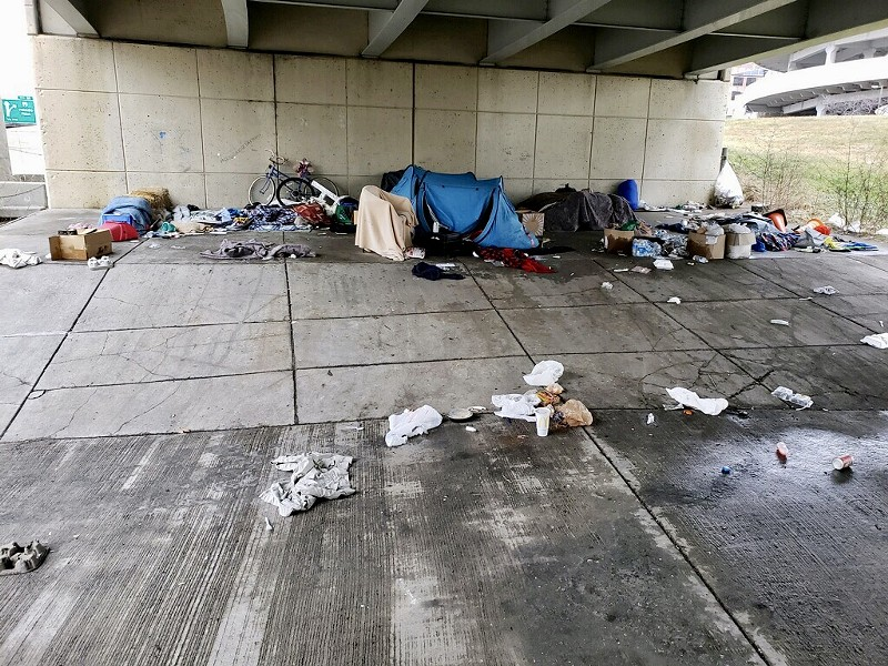 A makeshift homeless camp under an overpass by Joe Louis Arena before police seized the belongings. - COURTESY OF CITY OF DETROIT