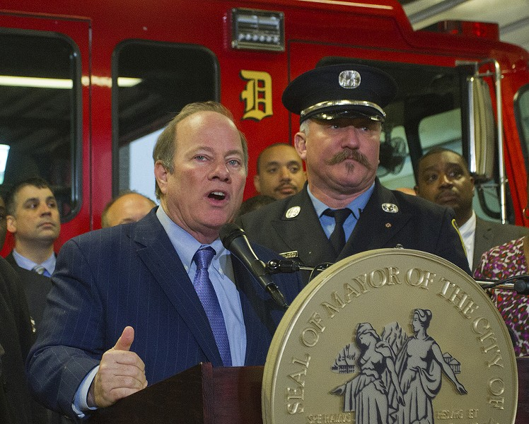 Mayor Duggan and Capt. Mike Nevin at a press conference. - STEVE NEAVLING