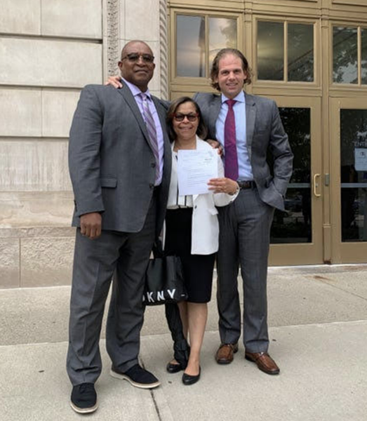 Cedric and Lisa Griffey with lawyer Jon Marko. - COURTESY OF MARKO LAW