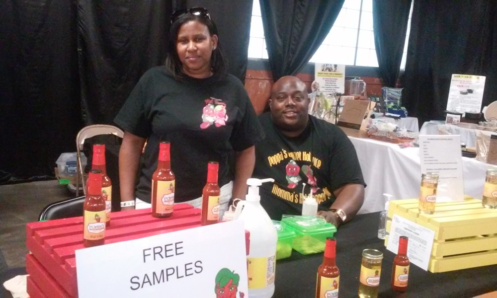 Roosevelt and D'Ette Walton of Ypsilanti, selling their Poppa's Gourmet Hot Sauce. - SERENA MARIA DANIELS