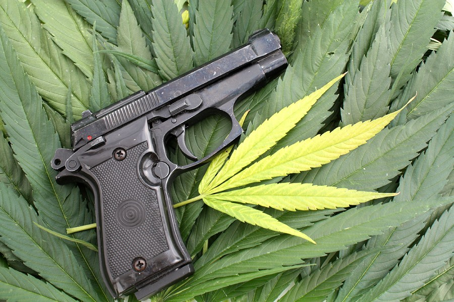 On the federal level, marijuana is still illegal, and it's a felony punishable by up to 10 years in prison to smoke pot and buy or own a gun. - SHUTTERSTOCK