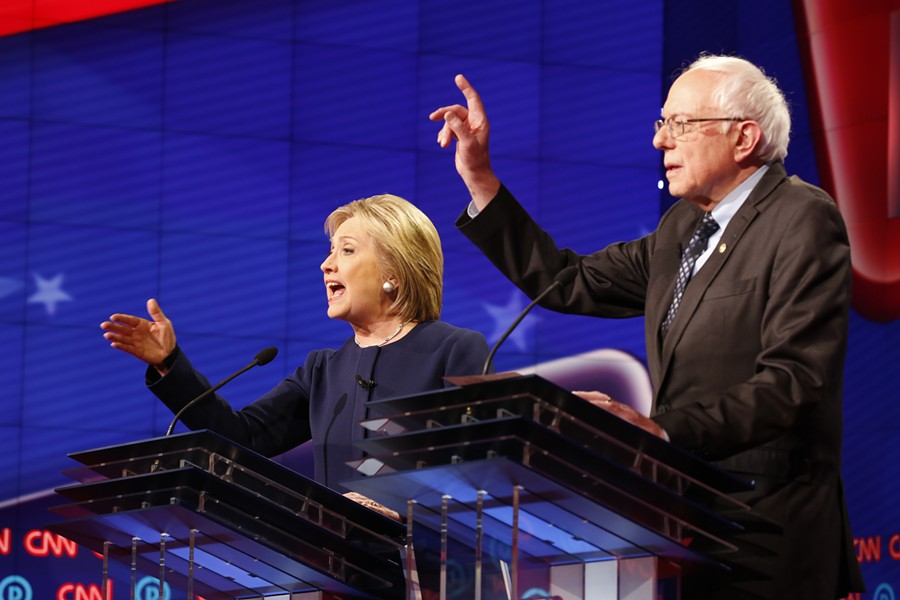 Former Secretary of State Hillary Clinton, left, and Vermont Sen. Bernie Sanders during Sunday's Democratic presidential debate at The Whiting Auditorium in Flint. - PHOTO COURTESY OF CNN