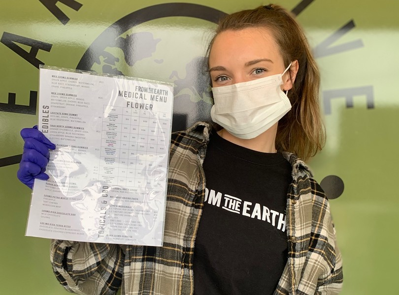 From the Earth employee holding a laminated menu. - FROM THE EARTH