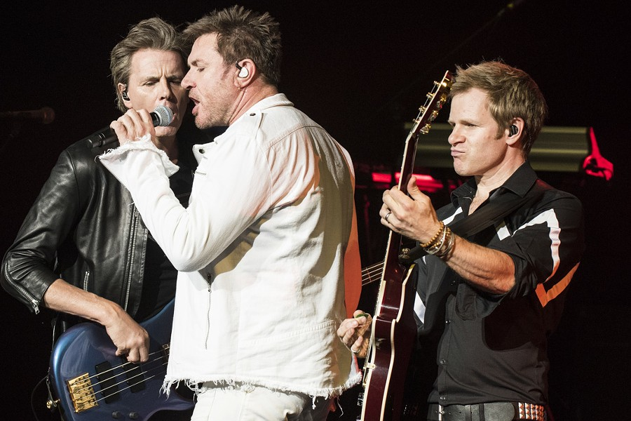Duran Duran's John Taylor, left, Simon Le Bon, and Dom Brown onstage at DTE Energy Music Theatre on Monday. - PHOTO BY MIKE FERDINANDE