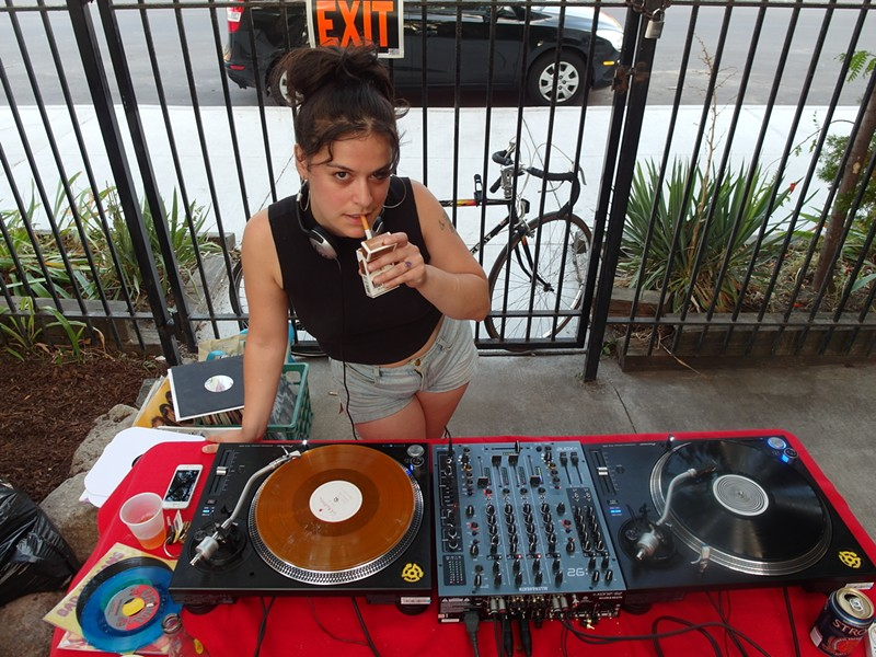 Jen David, aka Jenny Junior, spinning records. - PHOTO BY SERENA MARIA DANIELS