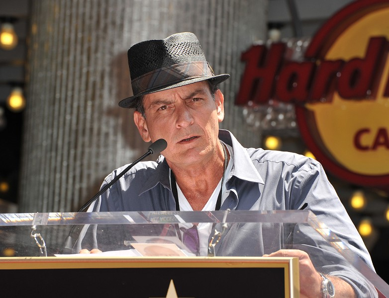 Charlie Sheen, absolutely rocking the fedora. - SHUTTERSTOCK