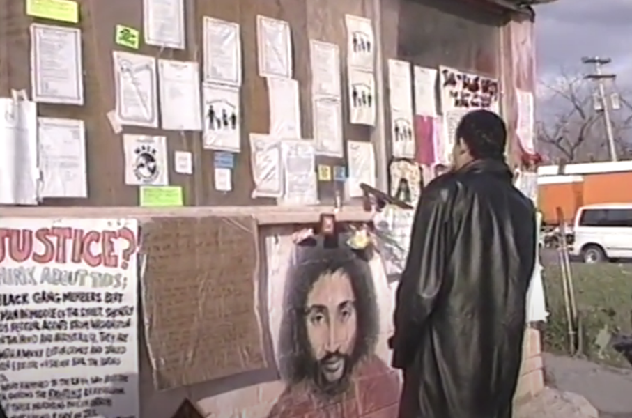 The Malice Green mural painted by Bennie White at the scene of his death in Detroit. - SCREEN GRAB/YOUTUBE