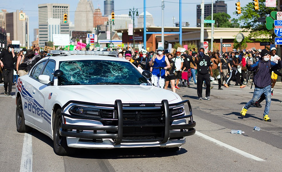 Protesters smashed the windows of a police car in Detroit. - STEVE NEAVLING
