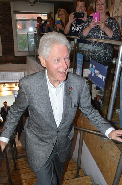 Former President Bill Clinton arrives at a campaign office in downtown Pontiac Monday. - PHOTO BY DUSTIN BLITCHOK