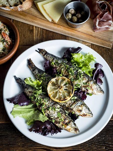 Sardinas Asadas – grilled fresh sardines, with grilled lemon, and tarragon at La Feria in the Cass Corridor. - © JOE VAUGHN