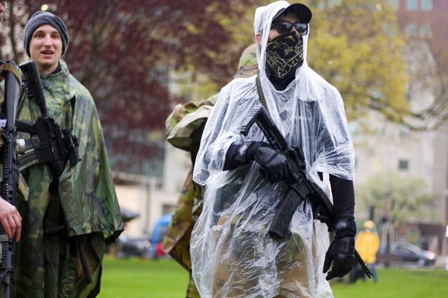 Armed protesters in Lansing protest Gov. Gretchen Whitmer's coronavirus lockdown. - STEVE NEAVLING