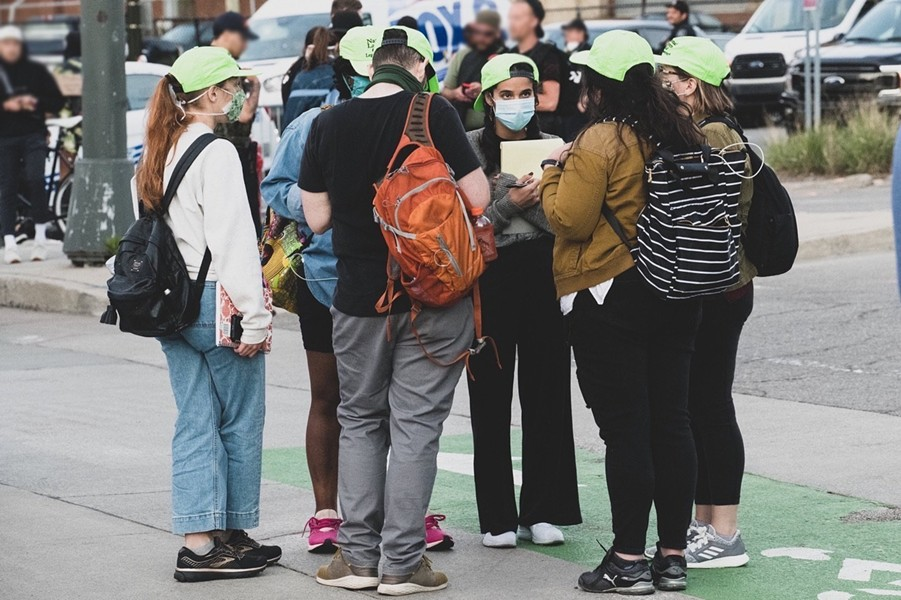 A group of legal observers from the National Lawyers Guild at a recent protest, easily identified by their bright green hats. - A.KHALID