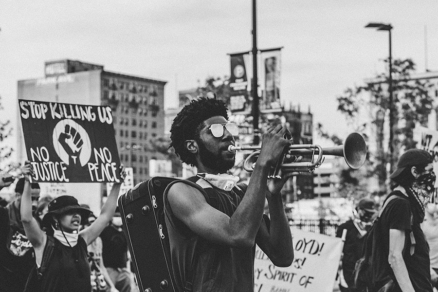 Allen Dennard at one of the many Detroit Will Breathe marches he attended this year. - MARC KLOCKOW