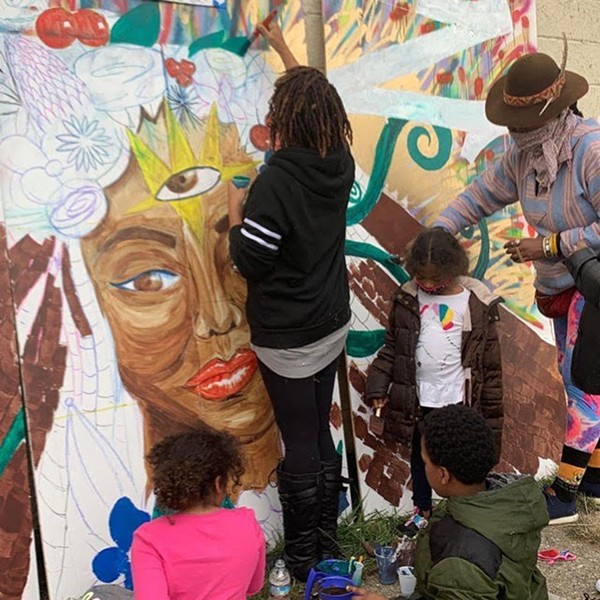 Artist Dana Selah Elam is honored with mural, which was recently created as part of a community workshop called The Honor Project. The mural will be on display at the Boll Family YMCA in downtown Detroit. - CAMERON JENKINS