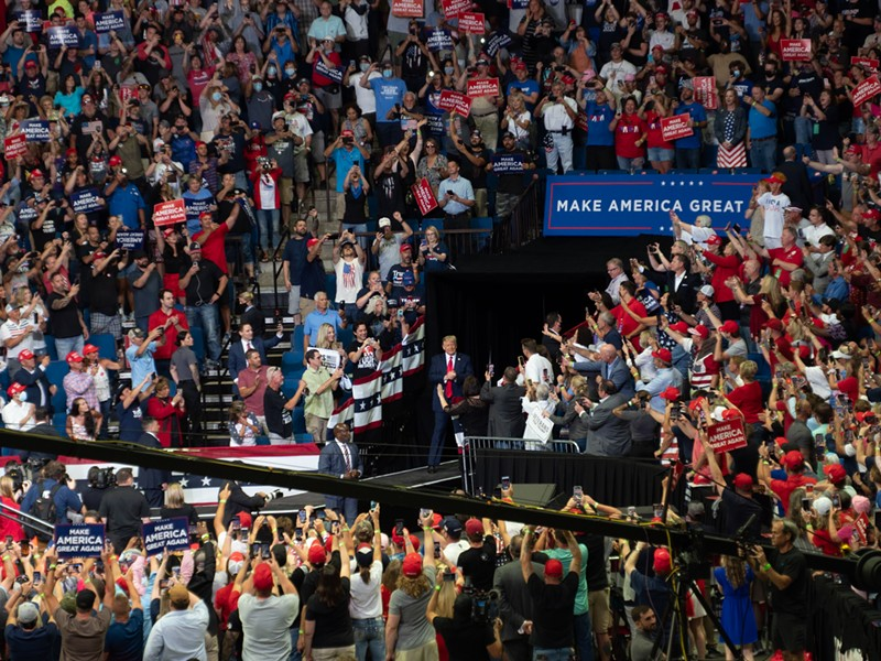 Trump at a rally in Tulsa, Okla., in June, where thousands of people gathered without wearing masks. - THRU_THE_GLASS, FLICKR CREATIVE COMMONS