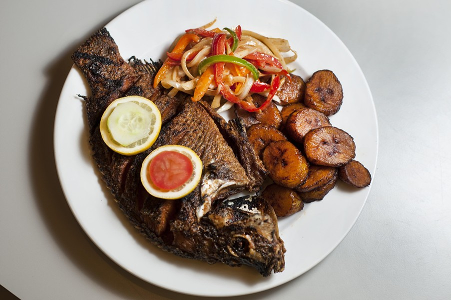 Grilled tilapia with plantains and marinated onions. - TOM PERKINS