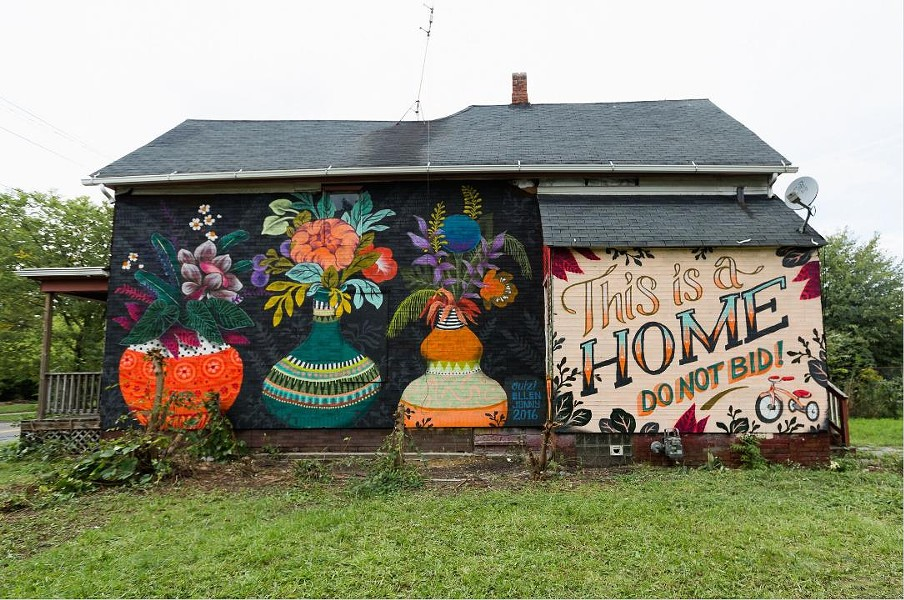 A message painted on a foreclosed Detroit home aims to make it easier for the family inside to buy it at auction. - MICHELE OBERHOLTZER