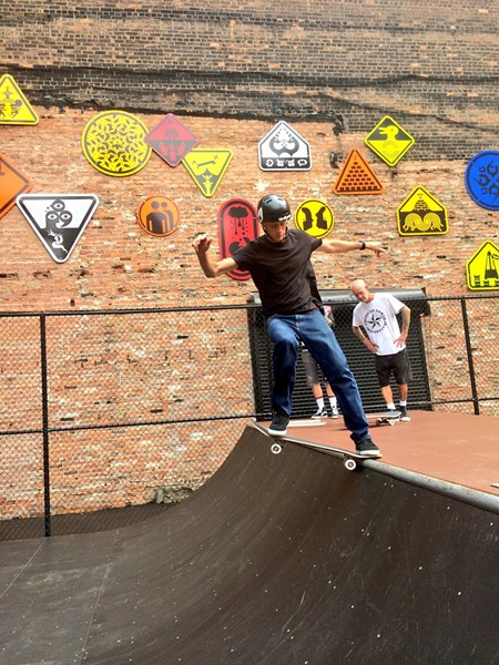 Tony Hawk skateboarding in front of Ryan McGinness artwork at Wayfinding Park, Detroit. - COURTESY PHOTO