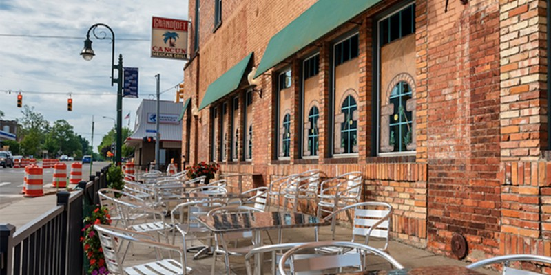 View of outside patio furniture for the Cancun Mexican Grill and the Grand Loft business at the corner of Bridge Street and Jefferson in Grand Ledge.