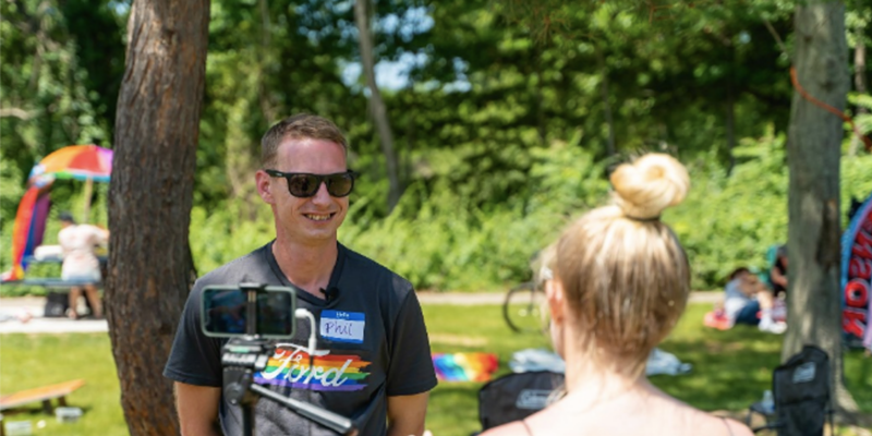 Macomb County Pride President Phil Gilchrist completing an interview during a Pride Picnic in Sterling Heights, June 2021.