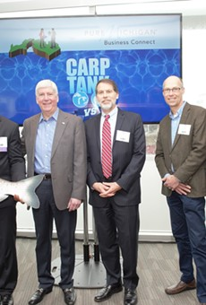 Edem Tsikata of Boston, Mass. accepts the grand prize at the Carp Tank from Gov. Rick Snyder, David Lodge, Jeff DeBoer and Dr. Denice Shaw.