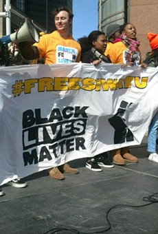 Activists hold a #FreeSiwatu banner at the March for Our Lives rally for gun reform on March 24, 2018 in Detroit.