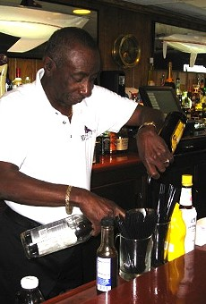 Jerome Adams mixing his signature drink behind the bar at Bayview Yacht Club in 2011.