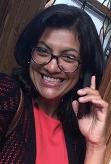 Rashida Tlaib, the Democratic primary winner for Michigan's 13th congressional district, takes a call from Sen. Bernie Sanders.