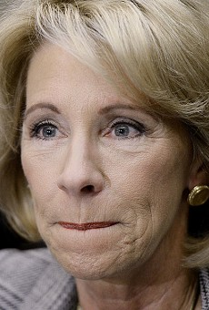 This person claims to run the Department of Education, but some say she's a puppet for the NRA.