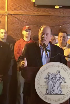 Mayor Mike Duggan announces the most recent expansion of the controversial Project Green Light to Corktown from inside McShane's Irish Pub
