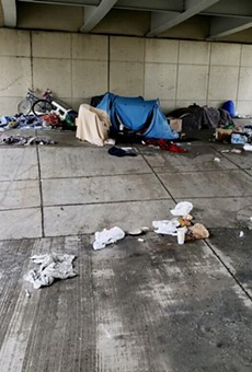 A makeshift homeless camp under an overpass by Joe Louis Arena before police seized the belongings.