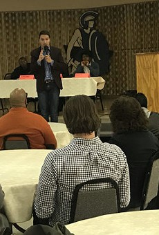 Igor Volsky with the group Guns Down America spoke at a town hall meeting Monday night in Flint.