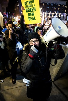 Detroit congresswoman Rashida Tlaib takes to the megaphone at a Green New Deal demonstration earlier this year.