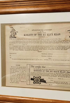 A framed Ku Klux Klan application form was left displayed in the house of a white Michigan police officer while a Black man was there with a real estate agent.