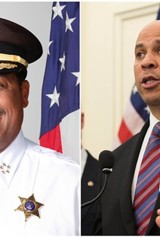 Sheriff Benny Napoleon (left) and presidential candidate Cory Booker.