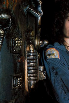 Sigourney Weaver as Ripley and Jonesy the cat.