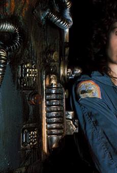 Sigourney Weaver as Ripley and Jonesy the cat.